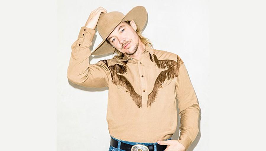 Diplo genre bends again. He wears a cowboy hat.